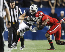 Rick Egan | Tribune file photo Utes defensive back Conroy Black, right, says,