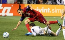 Real Salt Lake forward Fabian Espindola is tripped up by Chicago Fire defender Dan Gargan during RSL's 0-3 home loss in Rio Tinto Stadium. Stephen Holt/ Special to the Tribune