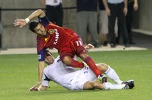 Real Salt Lake midfielder Javier Morales is tripped up by defender Gonzalo Segares during RSL's 0-3 home loss in Rio Tinto Stadium. Stephen Holt/ Special to the Tribune