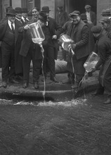 Courtesy New York Daily News Agents of the U.S. Prohibition Unit dump liquor in the gutter during liquor raid in New York City in 1922.