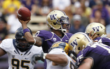 Washington quarterback Keith Price throws under pressure against California in the second half of an NCAA college football game, Saturday, Sept. 24, 2011, in Seattle. Washington won 31-23. Price threw for 292 yards and three touchdowns. (AP Photo/Elaine Thompson)