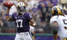 Washington quarterback Keith Price (17) drops back to pass as California's Aaron Tipoti moves in during the first half of an NCAA college football game, Saturday, Sept. 24, 2011, in Seattle. (AP Photo/Elaine Thompson)