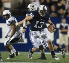 Rick Egan  | The Salt Lake Tribune    Brigham Young Cougars quarterback Riley Nelson (13) runs the ball on a quarterback keeper, as BYU defeated Utah State, 27-24 in Provo, Friday, September 30, 2011.