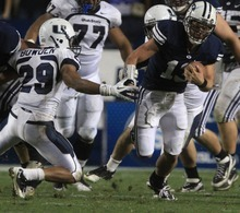 Rick Egan  | The Salt Lake Tribune    Brigham Young Cougars quarterback Riley Nelson (13) runs past Utah State Aggies safety Alfred Bowden (29) on a quarterback keeper, as BYU defeated Utah State, 27-24 in Provo, Friday, September 30, 2011.