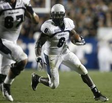 Rick Egan  | The Salt Lake Tribune   Utah State Aggies running back Robert Turbin (6) runs in for an easy touchdown, in football action, BYU vs. Utah State, in Provo, Friday, September 30, 2011.