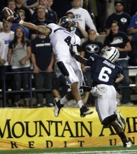 Rick Egan  | The Salt Lake Tribune    Utah State Aggies wide receiver Matt Austin (4) cant quite get his hand on the ball in the end zone, as  Brigham Young Cougars defensive back Jordan Johnson defends on the play, in football action, BYU vs Utah State,  in Provo, Friday, September 30, 2011
