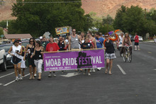 Lisa J. Church for The Tribune     A group of more than 300 people leaves Swanny City Park to march through downtown Moab during the town's first gay pride parade and festival.