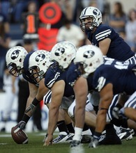 Trent Nelson  |  The Salt Lake Tribune BYU quarterback Jake Heaps at the line of scrimmage against Central Florida on Sept. 23, 2011.