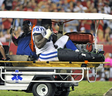 Indianapolis Colts defensive tackle Eric Foster is taken off the field after injuring his leg during the first half of an NFL football game against the Tampa Bay Buccaneers, Monday, Oct. 3, 2011, in Tampa, Fla. (AP Photo/Brian Blanco)