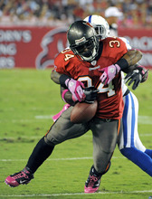 Tampa Bay Buccaneers running back Earnest Graham (34) can't hang on to a pass as he is hit from behind by Indianapolis Colts safety Antoine Bethea during the first half of an NFL football game, Monday, Oct. 3, 2011, in Tampa, Fla. (AP Photo/Brian Blanco)