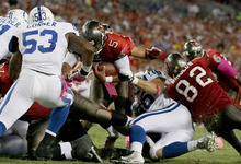 Tampa Bay Buccaneers quarterback Josh Freeman (5) scores a touchdown on a 1-yard run in the first half against the Indianapolis Colts in an NFL game, Monday, Oct. 3, 2011, in Tampa, Fla. (AP Photo/Margaret Bowles)