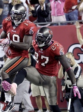 Tampa Bay Buccaneers wide receiver Mike Williams (19) celebrate with running back LeGarrette Blount (27) after Blount ran 35-yards for a touchdown in the fourth quarter of an NFL football game against the Indianapolis Colts, Monday, Oct. 3, 2011, in Tampa, Fla. (AP Photo/John Raoux)