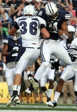 Rick Egan    The Salt Lake Tribune   Utah State Aggies cornerback McKade Brady hits Brigham Young Cougars  receiver Ross Apo during a game in Provo on Friday. Brady was ejected from the game following the play.