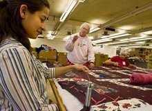 Mormons are expected to reach out to others. Here, workers labor at a Quilters Without Borders gathering at the LDS Humanitarian Center. Paul Fraughton /The Salt Lake Tribune 2008