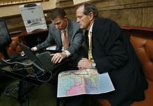 Scott Sommerdorf  |  The Salt Lake Tribune              Rep. Brad Dee, R-Ogden, right, majority leader of the House, works with Leif Elder, a policy analyst with the office of legislative research and general counsel, on adjusting a redistricting map on the floor of the House.