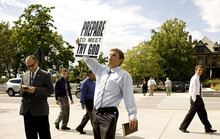 Jeremy Harmon  |  The Salt Lake Tribune  Street preacher Stephen Lutze, from Florida, yells out his message between sessions of the 181st Semiannual General Conference of The Church of Jesus Christ of Latter-day Saints on Saturday.