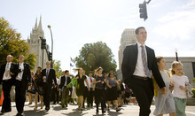 Jeremy Harmon  |  The Salt Lake Tribune  Conferencegoers head toward the Conference Center on their way to the afternoon session of the 181st Semiannual General Conference of The Church of Jesus Christ of Latter-day Saints on Saturday.