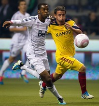 Vancouver Whitecaps' Carlyle Mitchell, left, and Real Salt Lake's Luis Gil chase down the ball during the first half of an MLS soccer game in Vancouver, British Columbia, on Thursday, Oct. 6, 2011. (AP Photo/The Canadian Press, Darryl Dyck)