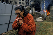 A Serb woman cries as homes are burned in Serb-held Sarajevo; Grbavica, Bosnia, March 18, 1996. Courtesy of Ron Haviv/VII