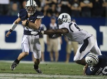 Rick Egan    The Salt Lake Tribune    Brigham Young Cougars quarterback Riley Nelson (13) runs the ball on a quarterback keeper, as BYU defeated Utah State, 27-24 in Provo, Friday, September 30, 2011.