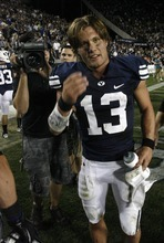 Rick Egan    The Salt Lake Tribune  BYU quarterback Riley Nelson (13) smiles after the game as the Cougars celebrate their victory over Utah State, at Lavell Edwards stadium,  in Provo, Friday, Sept. 30, 2011.