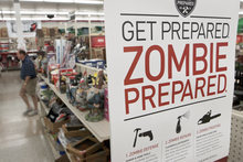 A sign promoting zombie preparadness is seen in a hardware store in Omaha, Neb., Monday, Oct. 10, 2011. The Westlake Ace Hardware stores are promoting tools and household items as