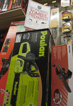 A sign promoting zombie preparedness is seen above chainsaws in a hardware store on Monday, Oct. 10, 2011, in Omaha, Neb. The Westlake Ace hardware chain with stores in seven states is offering tips on how to