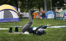 Scott Sommerdorf     The Salt Lake Tribune              One of the Occupy SLC campers (who chose not to be identified) does a yoga routine in the