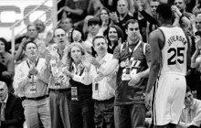 Steve Griffin  |  The Salt Lake Tribune   The front row fans slap hands with Utah's Al Jefferson as he comes out ot the game for a breather during second half action of the Utah Jazz Miami Heat game at the EnergySolutions Arena in Salt Lake City Wednesday, December 8, 2010.