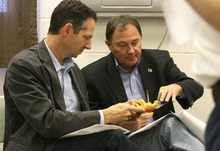 Leah Hogsten | The Salt Lake Tribune Governor Gary Herbert (right) and chief of staff Derek Miller taste a sampling of cheeses after touring the Dairy Farmers of America plant. Utah Governor Gary Herbert met with Dairy Farmers of America in Beaver and other Beaver county and city leaders to discuss how to grow of jobs in the county Friday, October 14 2011.