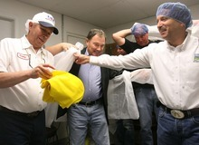 Leah Hogsten | The Salt Lake Tribune l-r Dairy Farmers of America  Beaver plant manager Craig Willden hands out shoe covers to Governor Gary Herbert, Utah Department of Agriculture and Food officer Larry Lewis and other Beaver County officials before touring the facility. Utah Governor Gary Herbert met with Dairy Farmers of America in Beaver and other Beaver county and city leaders to discuss how to grow of jobs in the county Friday, October 14 2011.