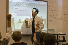 Paul Fraughton | The Salt Lake Tribune Science teacher Paul Chen teaches a lesson on carbon footprints on Friday, Oct. 14, at The McGillis School in Salt Lake City. The school receiveda  Gold LEED certificate for its green building practices employed in the expansion of the school building.