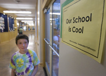 Paul Fraughton | The Salt Lake Tribune Benjamin, a student at The McGillis School in Salt Lake City, eyes a sign Friday, Oct. 14, as he walks down a hallway. The McGillis School was awarded a  Gold LEED certificate for its green building practices employed in the expansion of the school building.