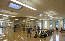 Paul Fraughton | The Salt Lake Tribune Students at the McGillis School in Salt Lake City listen Friday, Oct. 14,  to a presentation from Rocky Mountain Power about electricity. The students are sitting outside the main office in a space using natural light from skylights and large windows. The McGillis School was awarded a  Gold LEED certificate for its green building practices employed in the expansion of the school building.