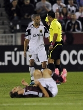Real Salt Lake defender Chris Wingert (17) gets a yellow card from the referee after tripping Colorado Rapids midfielder Brian Mullan during the first half of an MLS soccer game in Commerce City, Colo., Friday, Oct. 14, 2011. (AP Photo/Jack Dempsey)