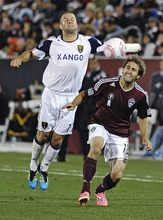 Real Salt Lake defender Chris Wingert (17) and Colorado Rapids midfielder Brian Mullan (11) go after the ball during the first half of an MLS soccer game in Commerce City, Colo., Friday, Oct. 14, 2011. (AP Photo/Jack Dempsey)