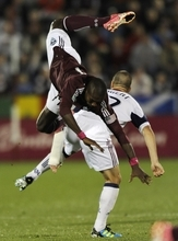 Colorado Rapids forward Omar Cummings (14) flies over Real Salt Lake defender Chris Wingert (17) during the first half of an MLS soccer game in Commerce City, Colo., Friday, Oct. 14, 2011. (AP Photo/Jack Dempsey)