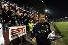 Real Salt Lake goalkeeper Nick Rimando (18) reacts to keeping the Rocky Mountain Cup following an MLS soccer game against the Colorado Rapids in Commerce City, Colo., Friday, Oct. 14, 2011. The team's tied 0-0 and Real Salt Lake kept the Rocky Mountain Cup. (AP Photo/Jack Dempsey)