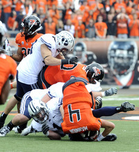 Oregon State's quarterback Sean Mannion (4) is sacked by BYU's Jordan Pendleton (1) during the first half of an NCAA college football game in Corvallis, Ore., Saturday Oct. 15, 2011. (AP Photo/Greg Wahl-Stephens)
