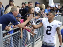 BYU's Cody Hoffman (2) is congratulated by fans as he leaves the stadium after a 38-28 win against Oregon State in an NCAA college football game in Corvallis, Ore., Saturday Oct. 15, 2011. (AP Photo/Greg Wahl-Stephens)