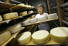 Scott Sommerdorf  |  The Salt Lake Tribune              Jennifer Hines checks the aging room, Thursday, Oct. 13, 2011. Rockhill Cheese Creamery in Richmond, owned by Hines and her husband Pete Schropp, has been honored  by the National Trust for Historic Preservation. It's one of only a few places in Utah to earn this prestigious award.
