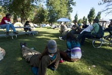 Chris Detrick  |  The Salt Lake Tribune Participants talk at the Occupy SLC camp at Pioneer Park Tuesday October 18, 2011.