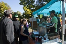 Chris Detrick  |  The Salt Lake Tribune Volunteers Chris Parrilla and Natasha Deininger serve vegetable soup and rice at the Occupy SLC camp at Pioneer Park Tuesday October 18, 2011.