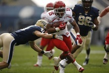 Trent Nelson  |  The Salt Lake Tribune Utah running back John White runs past Pitt's Andrew Taglianetti during the first half. Utah vs. Pitt, college football at Heinz Field Stadium in Pittsburgh, Pennsylvania, Saturday, October 15, 2011.
