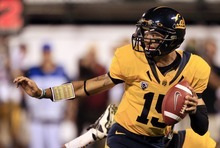California quarterback Zach Maynard drops back to pass against Southern California during the second quarter of an NCAA college football game in San Francisco, Thursday, Oct. 13, 2011. (AP Photo/Marcio Jose Sanchez)