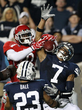 Utah wide receiver DeVonte Christopher (10) is unable to come up with a 14-yard pass by Jordan Wynn in the end zone, as BYU cornerback Preston Hadley (7) and safety Travis Uale (23) defends, during the second half of an NCAA college football game, Saturday, Sept. 17, 2011, at LaVell Edwards Stadium in Provo, Utah. Utah defeated BYU 54-10. (AP Photo/Colin E Braley)