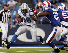 Detroit Lions' Jerome Harrison (36) runs the ball during the first half of an NFL preseason football game against the Buffalo Bills in Orchard Park, N.Y., Thursday, Sept. 1, 2011. (AP Photo/Derek Gee)