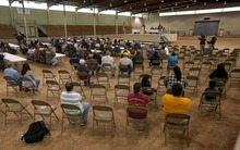 Produce farmers listen during a meeting of farmers and state officials to discuss the impact of the Alabama Immigration law on their livelihoods in Oneonta, Ala., Thursday, Oct. 20, 2011. (AP Photo/Dave Martin)