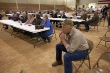 Farmer Scott Allgood, front, of Allgood, Ala., listens during a meeting of farmers and state officials to discuss the impact of the Alabama Immigration law on their livelihoods in Oneonta, Ala., Thursday, Oct. 20, 2011. (AP Photo/Dave Martin)