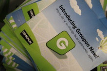 Rex Arbogast  |  The Associated Press Groupon Now literature stacked at the  online coupon company's Chicago offices Thursday, Sept. 22, 2011. Online coupon seller Groupon Inc. is discounting its expectations for its first stock offering, reported Friday.